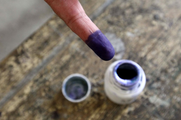 May 23, 2012: An Egyptian man shows his ink-stained finger after voting in the country's first free presidential election at a polling station in Cairo. (Khaled Desouki/AFP/GettyImages)