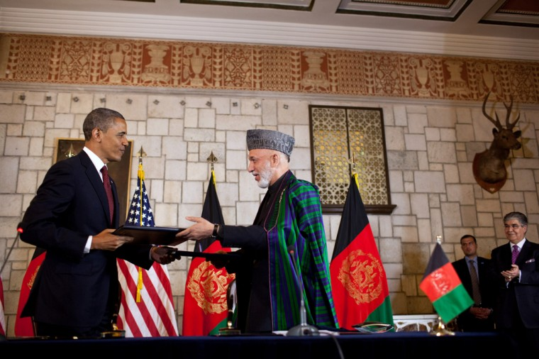 President Barack Obama and Afghan President Hamid Karzai exchange documents after signing the strategic partnership agreement at the Presidential Palace in Kabul, Afghanistan, May 1, 2012. (Pete Souza/White House)
