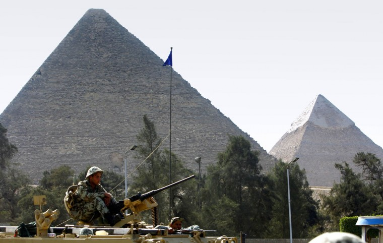 January 31, 2011: Army soldiers atop an Armoured Personel Carrier (APC) guard the area near the Pyramids in Cairo. Protesters intensified their campaign on Monday to force Egypt's President Hosni Mubarak to quit as world leaders struggled to find a solution to a crisis that has torn up the Middle East political map. The cabinet has formally resigned, but protesters are seeking a regime change with the resignation of Mubarak. (Yannis Behrakis/Reuters)