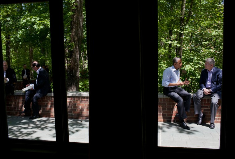 President Barack Obama talks with Prime Minister Stephen Harper of Canada on the Laurel Cabin patio during the G8 Summit at Camp David, Md., May 19, 2012. (Pete Souza/White House)