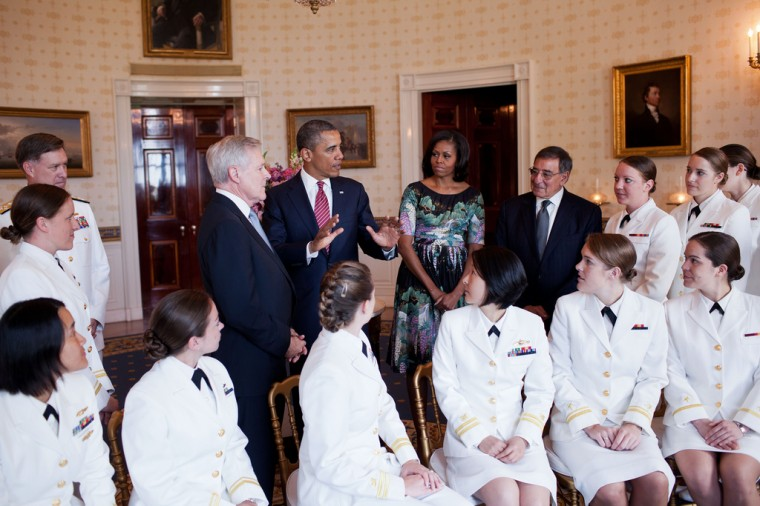 President Barack Obama and First Lady Michelle Obama greet the U.S. Navy's first contingent of women submariners to be assigned to the Navy's operational submarine force, in the Blue Room of the White House, May 28, 2012. The 24 women were accepted into the Navy's nuclear submarine program after completing an intensive training program and serve on ballistic and guided missile submarines throughout the Navy. Also attending were ADM Mark Ferguson, left, Navy Secretary Ray Mabus and Defense Secretary Leon Panetta, right. (Pete Souza/White House)