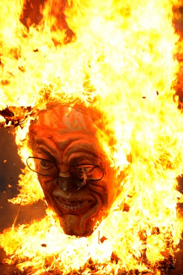 A burning effigy of Philippine President Benigno Aquino is seen during May Day protests in Manila held to push for higher wages and policies that would make it harder to fire workers. Aquino has said he is trying to help labor workers but has warned that giving too many benefits will make the country less competitive, costing more jobs. (Noel Celis/GettyImages)