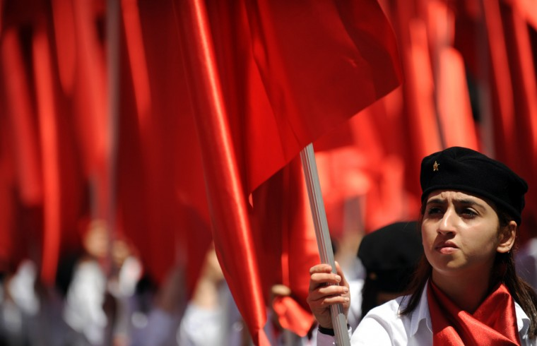 Protesters march with red flags in Taksim square during a May Day rally in central Istanbul. (Bulent Kilic/AFP/GettyImages)