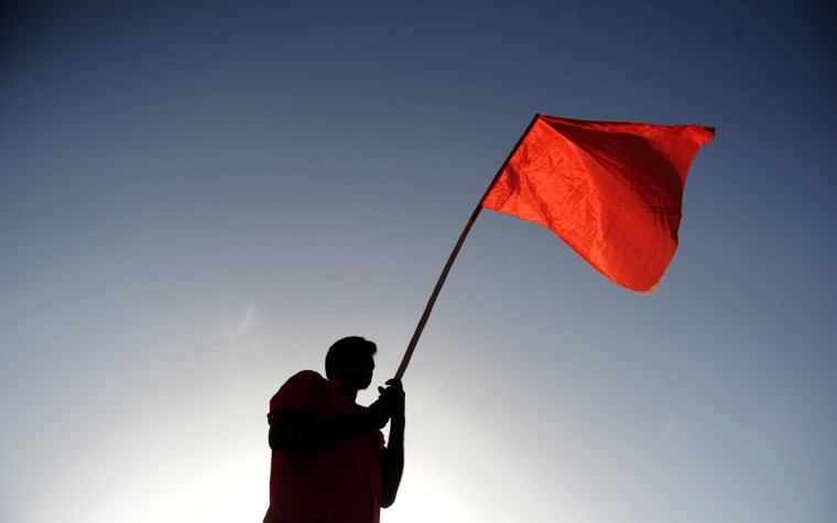 A supporter of the Sri Lankan Marxist JVP or People's Liberation Front waves a red flag during the annual May Day parade in Colombo. (Ishara S.Kodikara/AFP/GettyImages)