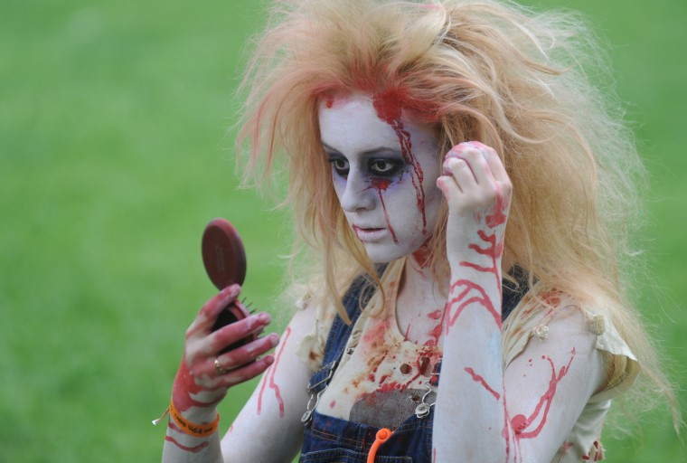 Primping Zombie... A girl dressed as zombie looks in the mirror during a zombie walk in Prague. (Michal Cizek/AFP/GettyImages)