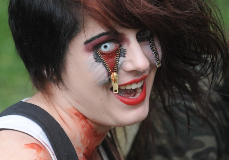 Zippered zombie.... A girl dressed as a zombie participates in a zombie walk in Prague. (Michal Cizek/AFP/GettyImages)
