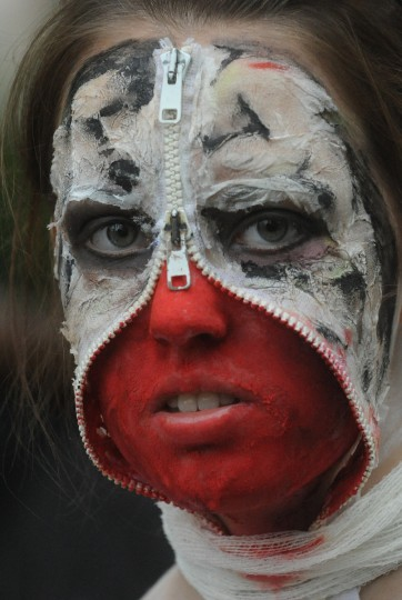 Double zippered.... A girl dressed as a zombie participates in a zombie walk in Prague. (Michal Cizek/AFP/GettyImages)