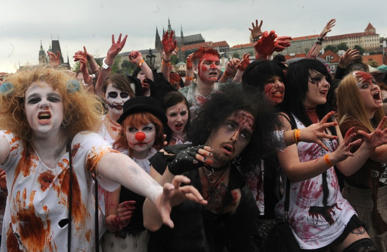 Clown nose?... Youths participate in a zombie walk in Prague. (Michal Cizek/AFP/GettyImages)