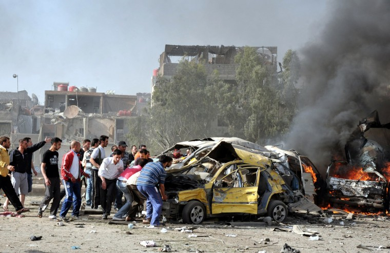 Two powerful blasts struck Damascus during morning rush hour, killing scores, wounding dozens and prompting the UN observer chief to appeal for help to end the bloodshed ravaging Syria. (Syrian Arab News Agency/Getty images)
