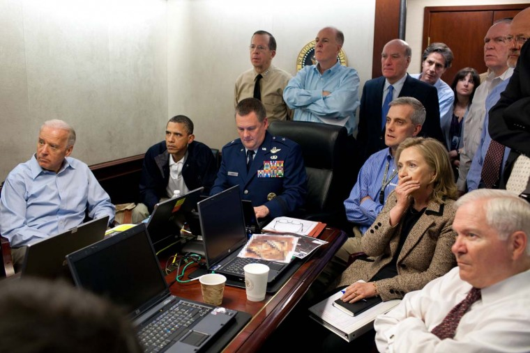 President Barack Obama, Vice President Joe Biden, Secretary of State Hillary Clinton, Secretary of Defense Robert Gates and members of the national security team receive an update on the mission against Osama bin Laden in the Situation Room of the White House May 1, 2011 in Washington, D.C. The anniversary of the death of Osama Bin Laden during a raid by U.S. military forces was marked on May 2. (Pete Souza/The White House via Getty Images)