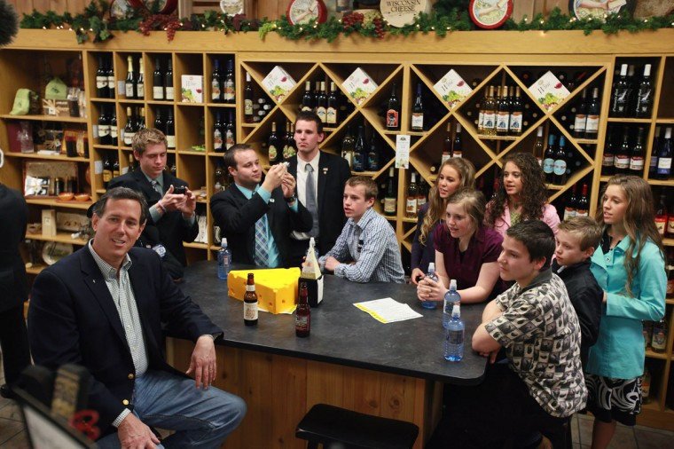 "Former U.S. Senator and potential presidential candidate Rick Santorum received a great endorsement, not to mention photo opportunity, for his staunchly held pro-life views during this campaign stop in Appleton, Wisconsin. Pictured: Santorum has lunch with members of the Duggar family from the reality show ""19 Kids & Counting"" at Simon's Specialty Cheese on April 2, 2012. (Scott Olson/Getty Images)"