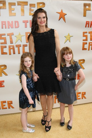 "Along with a lengthy acting and modeling career, Brooke Shields is a longtime advocate and published author on the topic of diagnosing and treating postpartum depression. Pictured: Shields and children Rowan Francis Henchy and Grier Hammond Henchy attend the opening night of ""Peter And The Starcatcher"" on Broadway at The Brooks Atkinson Theatre on April 15, 2012 in New York City. (Neilson Barnard/Getty Images)"