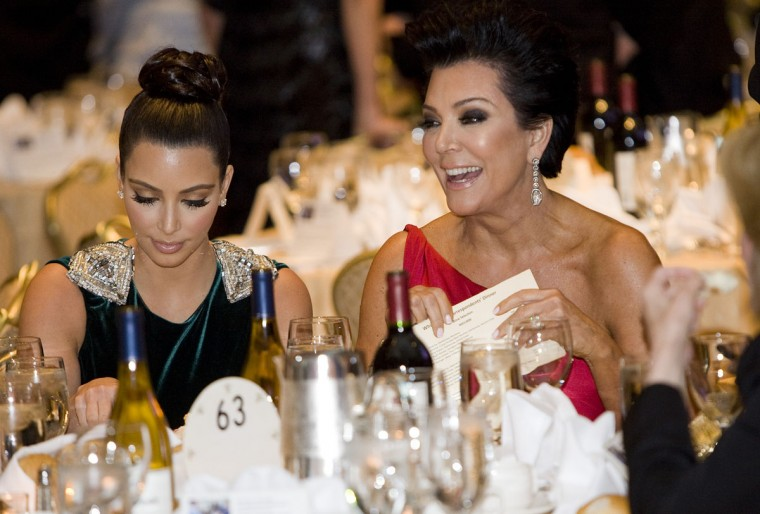 Kim Kardashian (L) was the first of Kris Jenner's (C) six children to gain public attention in 2007 from a leaked sex tape made in 2003. Since then, her social activities, and other style-related business ventures, have helped spread the Kardashian name to the masses. Pictured: Kim and Kris attend the 2012 White House Correspondents' Association Dinner held at the Washington Hilton on April 28, 2012 in Washington, DC. (Kristoffer Tripplaar-Pool/Getty Images)