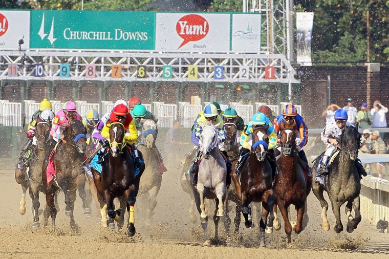 The field comes down the front stretch during the 138th running of the Kentucky Derby at Churchill Downs on May 5, 2012. (Elsa/Getty Images)