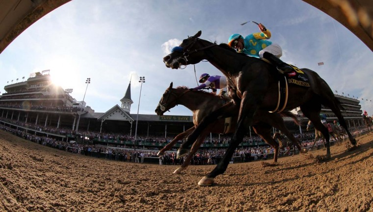 Mario Gutierrez (L) comes down the final stretch atop I'll Have Another ahead of Bodemeister ridden by Mike Smith at Churchill Downs on May 5, 2012. (Rob Carr/Getty Images)