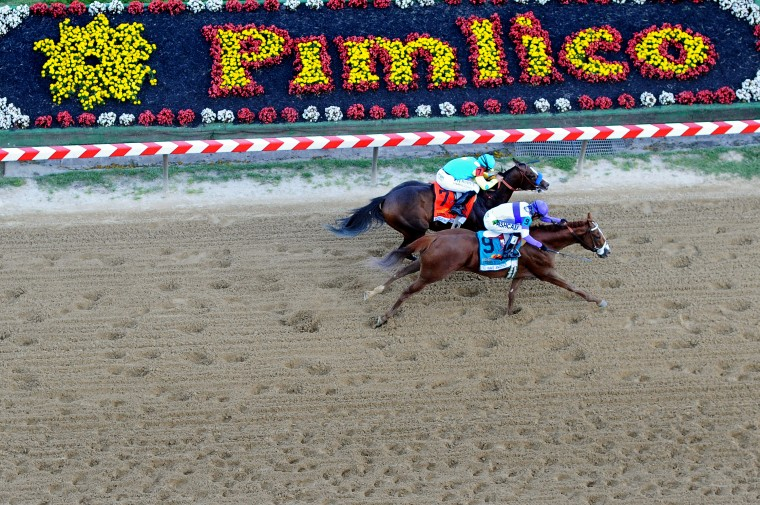 I'll Have Another #9 ridden by Mario Gutierrez beats Bodemeister #7 ridden by Mike E. Smith at the finish line to win the 137th running of the Preakness Stakes at Pimlico Race Course on May 19, 2012 in Baltimore, Maryland. (Patrick Smith/Getty Images)