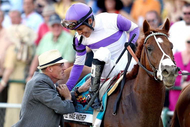 Mario Gutierrez is congratulated by Dennis O'Neill after riding I'll Have Another to win the 137th Preakness Stakes at Pimlico Race Course on May 19, 2012 in Baltimore, Maryland. (Matthew Stockman/Getty Images)