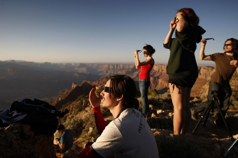 People watch as an eclipse reaches annularity as the moon passes before the sun in the first annular eclipse seen in the U.S. since 1994 on May 20, 2012 in Grand Canyon National Park, Arizona. (David McNew/Getty Images)