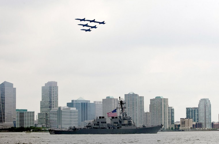 The U.S. Navy Blue Angels fly in formation as they pass over the USS Donald Cook (DDG 75) on the Hudson River during the Parade of Ships for the start of Fleet Week May 23, 2012 in New York City. (Allison Joyce/Getty Images)