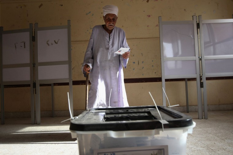 May 23, 2012: A voter walks to cast his ballot in Egypt's presidential election in Faiyum, Egypt. (John Moore/Getty Images)