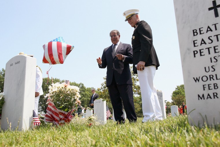 U.S. Secretary of Defense Leon Panetta ( L) talks with a member of the U.S. Military as he visits graves in Section 60 on Memorial Day at Arlington National Cemetery on May 28, 2012 in Arlington, Virginia. Section 60 is reserved for veterans of the Iraq War. For Memorial Day U.S. President Barack Obama is paying tribute to military veterans past and present who have served and sacrificed their lives for their country. (Mark Wilson/Getty Images)