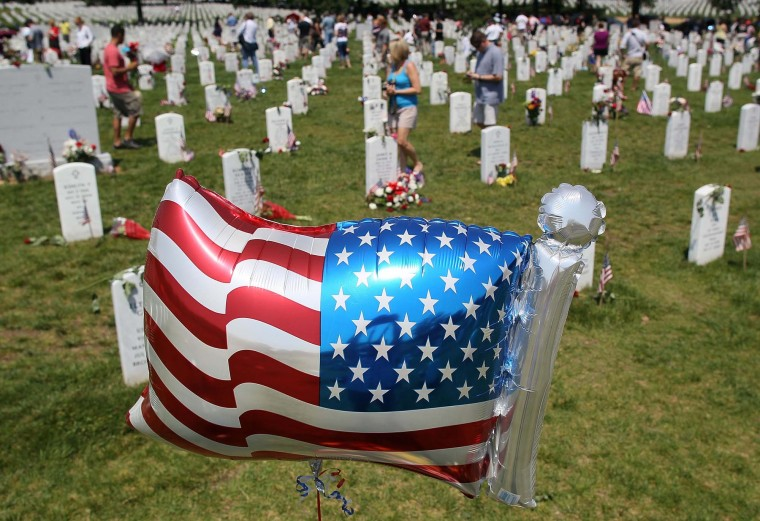 An American flag ballon flies at Section 60 on Memorial Day at Arlington National Cemetery on May 28, 2012 in Arlington, Virginia. Section 60 is reserved for veterans of the Iraq War. (Mark Wilson/Getty Images)