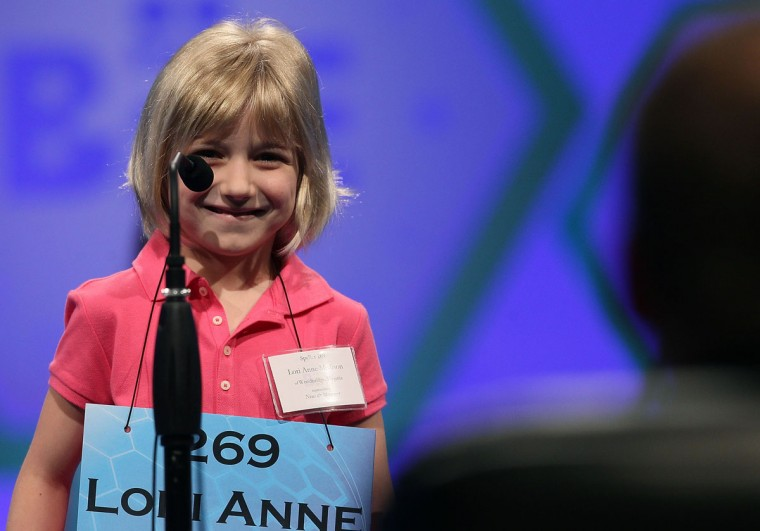 May 30, 2012: 6-year old Lori Anne C. Madison smiles after spelling a word correctly during the second round of the 2012 Scripps National Spelling Bee competition in National Harbor, Maryland. (Mark Wilson/Getty Images)