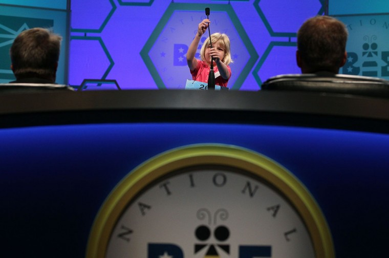 May 30, 2012: 6-year old Lori Anne C. Madison from Woodbridge, Virginia, the youngest speller on record with the Scripps National Spelling Bee, adjusts the microphone before spelling a word correctly during the second round in National Harbor, Maryland. (Mark Wilson/Getty Images)