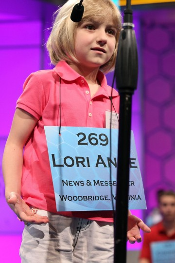 "May 30, 2012: Six-year-old Lori Anne Madison reacts after mispelling the word ""ingluvies"" during the third round of the 2012 Scripps National Spelling Bee competition in National Harbor, Maryland. Lori who is the youngest speller to participate failed to make it to the finals of the annual competition. (Mark Wilson/Getty Images)"