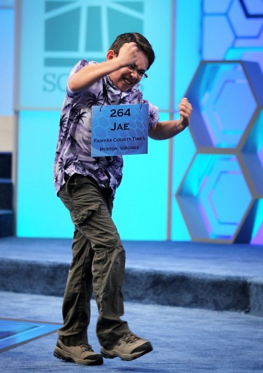 May 31, 2012: Spelling Bee contestant Jae Canetti of Fairfax, Virginia, celebrates after he correctly spelled his word during the round 4 of the 84th annual Scripps National Spelling Bee competition at the Gaylord National Resort and Convention Center in National Harbor, Maryland. Fifty spellers have advanced to compete in the semifinals on the last day of the competition. (Alex Wong/Getty Images)
