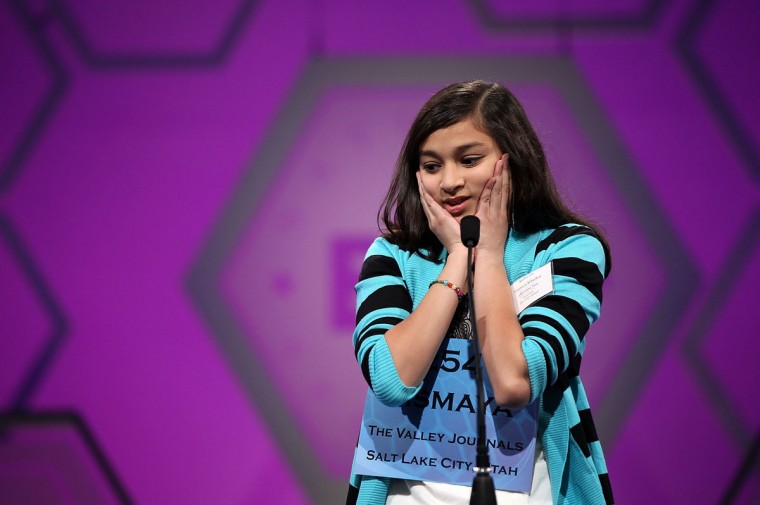 May 31, 2012: Spelling Bee contestant Vismaya Jui Kharkar of Bountiful, Utah, tries to spell her word during round 6 of the 84th annual Scripps National Spelling Bee competition at the Gaylord National Resort and Convention Center in National Harbor, Maryland. Nine spellers have advanced to compete in the final of the competition. (Alex Wong/Getty Images)