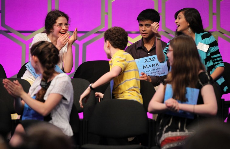 May 31, 2012: Finalist Jordan Hoffman (bottom left) claps for fellow finalist Lena Greenberg (top left) as she celebrates spelling her word correctly during round 6 of the 84th annual Scripps National Spelling Bee competition in National Harbor, Maryland. (Alex Wong/Getty Images)