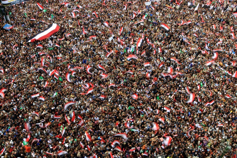 November 18, 2011: Tens of thousands of Egyptian protesters wave national flags during a rally held in Cairo's landmark Tahrir Square with the aim of pushing Egypt's ruling military to cede power, 10 months after an uprising that toppled Hosni Mubarak's regime. (Khaled Desouki/AFP/Getty Images)