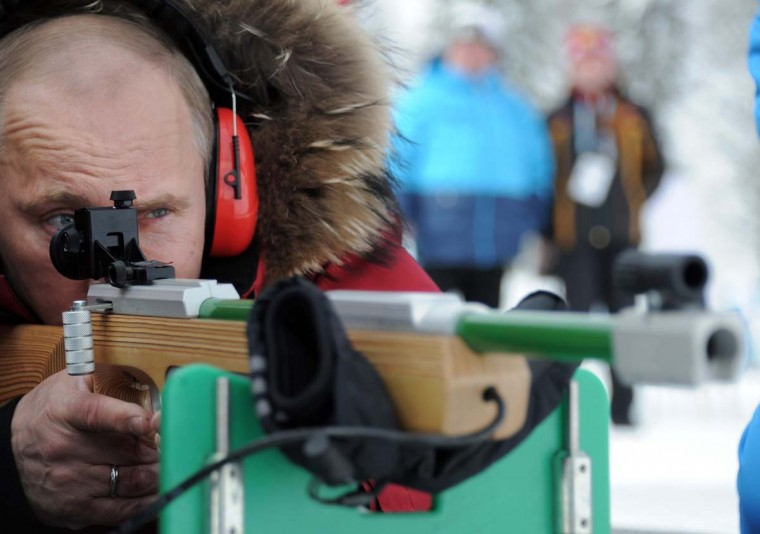2012: Vladimir Putin aims as he tries a sport gun at the national championship on ski races and biathlon for athletes with locomotor and vision disorders in the Laura sports complex outside Sochi on March 9, 2012. (Alexey Druzhinin/AFP/Getty Images)