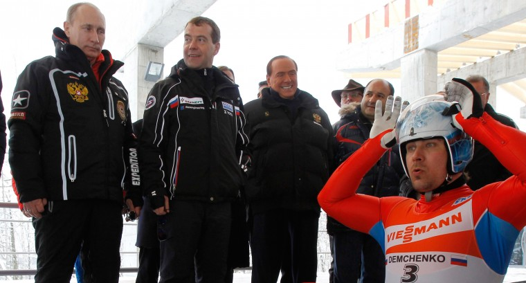 2012: Vladimir Putin (L), Russia's outgoing President Dmitry Medvedev (C) and former Italy's Prime minister Silvio Berlusconi (R) attend a training session as they visit the luging sport center at the alpine ski resort in Krasnaya Polyana, some 50kms from Sochi on March 9, 2012. (Dmitry Astakhov/AFP/Getty Images)
