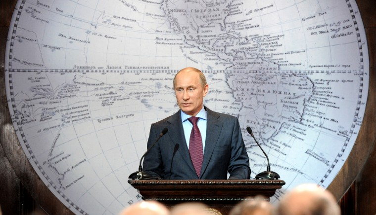2012: Prime Minister and President-elect Vladimir Putin (C) speaks in the Russian Geographical Society in St. Petersburg on April 10, 2012. (Yana Lapikova/AFP/Getty Images)