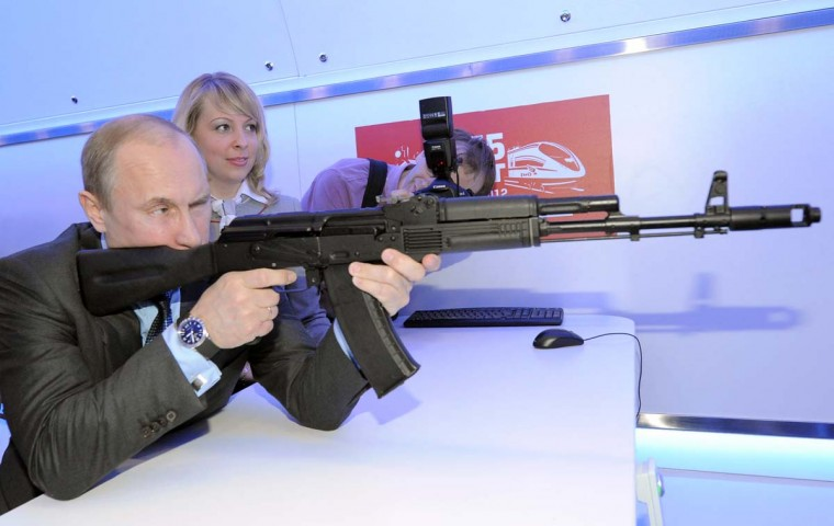 2012: Prime Minister and President-elect Vladimir Putin aims at a target with a replica of a Kalashnikov assault rifle in Moscow, on April 26, 2012, while visiting a shooting gallery at an exhibition of Russian Railways' research center. (Alexey Druzhinin/AFP/Getty Images)