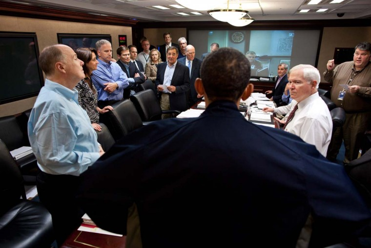 """This May 1, 2011 official White House photo shows President Barack Obama with members of the national security team at the conclusion of one in a series of meetings discussing the mission against Osama bin Laden. Nearly a year after a U.S. raid killed Osama bin Laden, his core al-Qaida network in Pakistan is """"essentially gone"""" but its affiliates remain a threat, U.S. intelligence officials said April 27, 2012. (Pete Souza/AFP/Getty Images)"""