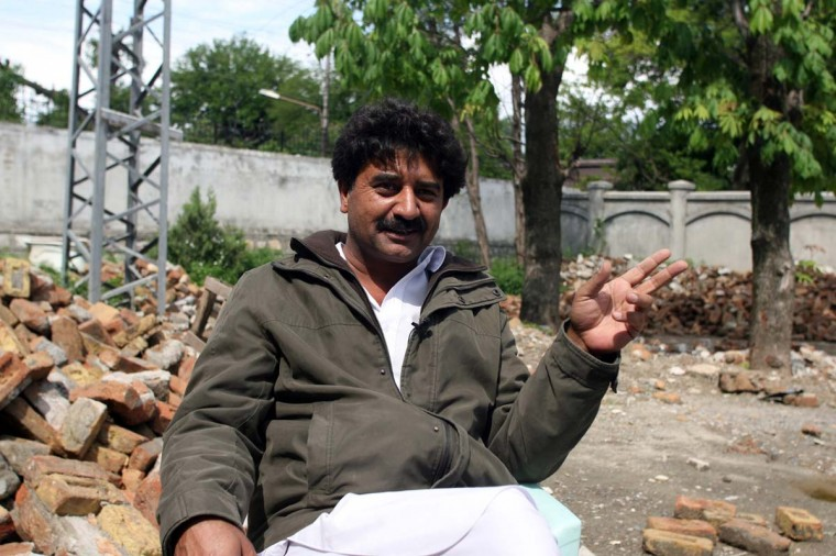 This photograph taken on May 1, 2012 shows Shakeel Ahmad Yusufzai, a Pakistani contractor, at his residence in northern Abbottabad. He is the man who demolished Osama bin Laden's house and despite Taliban death threats, he says he is proud of what he did. The high-walled three-story house was flattened in February 2012 and now Yusufzai gives away bricks to curious souvenir-hunters from all over Pakistan. (Sajjad Qayyumsa/AFP/Getty Images)