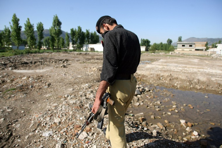 A Pakistani policeman walks at the site of the demolished compound of slain al-Qaida leader Osama bin Laden in northern Abbottabad on May 2, 2012. Pakistan was in a state of high alert over fears terrorists could mark the first anniversary of bin Laden's killing with revenge attacks. (Sajjad Qayyumsa/AFP/Getty Images)