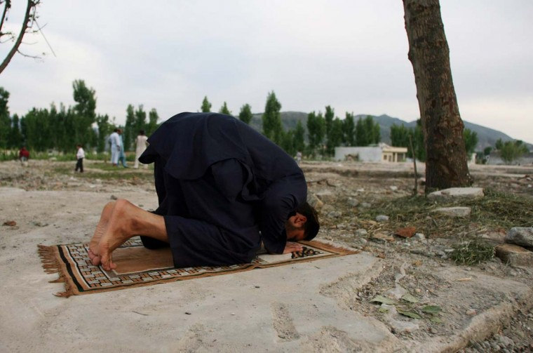 A Pakistani man prays near the site of the demolished compound of slain al-Qaida leader Osama bin Laden in Abbottabad, on May 2, 2012. (Sajjad Qayyumsa/AFP/Getty Images)