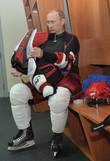 Russia's President Vladimir Putin puts on his hockey equipment to play a game at the All-Russian ice hockey festival among amateur teams at Megasport Arena in Moscow, May 7, 2012. Putin played for Team of the Russian Amateur Ice Hockey League, which competed with the Russian Legends Team. (Alexei Nikolsky/AFP/Getty Images)