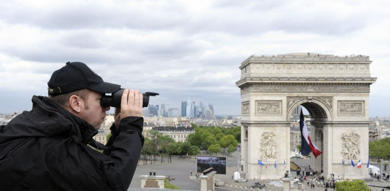 May 8, 2012: A member of the French Paris National Police Intervention Group watches the area next to the triumph arc where France's outgoing president and president-elect will take part in the ceremony marking the 67th anniversary of the Allied victory over Nazi Germany in Paris. (Bertrand Guay/AFP/Getty Images)