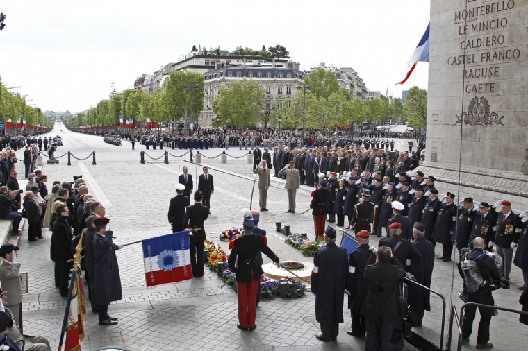 May 8, 2012: France's outgoing president Nicolas Sarkozy (R) and president-elect Francois Hollande (L) attend a ceremony marking the 67th anniversary of the Allied victory over Nazi Germany at the Arc de Triomphe in Paris. Hollande and ousted rival Sarkozy laid a wreath at the Tomb of the Unknown Soldier as France marked the anniversary of the end of World War II in Europe. (Jacky Naegelen/AFP/Getty Images)