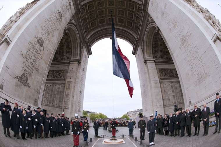 May 8, 2012: French soldiers parade during a ceremony marking the 67th anniversary of the Allied victory over Nazi Germany in World War II at the Arc de Triomphe in Paris. (Lionel Bonaventure/AFP/Getty Images)
