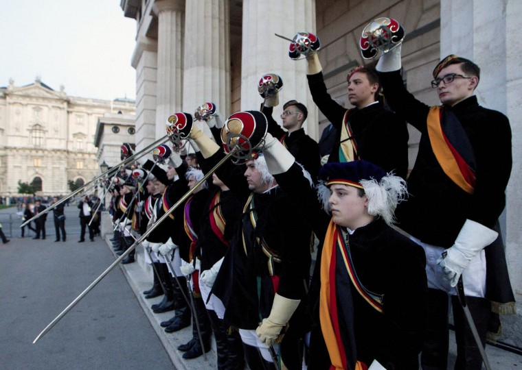 """May 8, 2012: Austrian fraternity members take part in a commemoration ceremony and a rally of far -right students corporations on the """"""""Day for memory to the victims"""" of World War II, as Austria marked the anniversary of the end of World War II in Europe, at the Heldenplatz in Vienna. (Dieter Nagl/AFP/Getty Images)"""