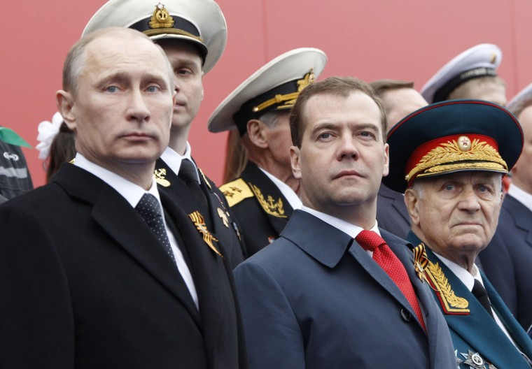 Russia's newly-inaugurated President Vladimir Putin (L) and new Prime Minister Dmitry Medvedev (C) watch Victory Day parade at the Red Square in Moscow, on May 9, 2012. Thousands of Russian soldiers marched today across Red Square to mark the 67 years since the victory over Nazi Germany in World War II. (Vladimir Rodionov/AFP/Getty Images)