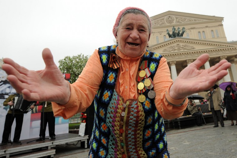 May 9, 2012: Wearing medals an elderly woman dances in front of the Bolshoi Theatre, a traditional veterans meeting place, in Moscow. (Kirill Kudryavtsev/AFP/Getty Images)