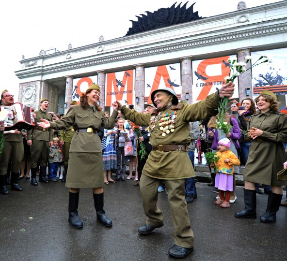 May 9, 2012: Wearing World War II-era Red Army field uniform and medals a veteran (C) dances with actors in Gorky park, a traditional veterans meeting place, in Moscow. (Yuri Kadobnov/AFP/Getty Images)