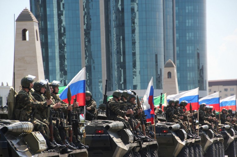 May 9, 2012: Police special forces officers ride atop an armoured personnel carriers during Victory Day parade in the Chechnya's capital Grozny. (STR/AFP/Getty Images)